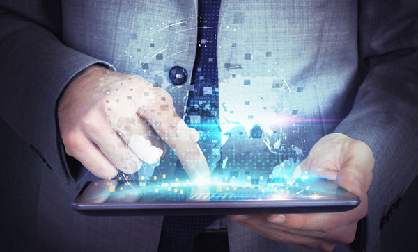 Solve and Evolve in Banking and Financial Services: The Drive to Digital - Man Handling data digitally | Iron Mountain