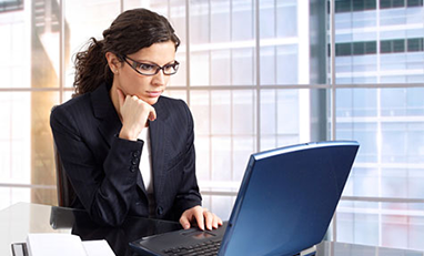 woman sitting looking at laptop