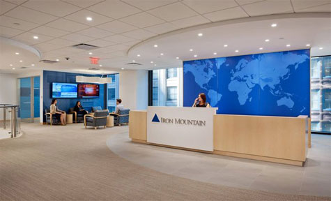 Iron Mountain Receives LEED Gold Certification At New HQ - Receptionist at desk | Iron Mountain