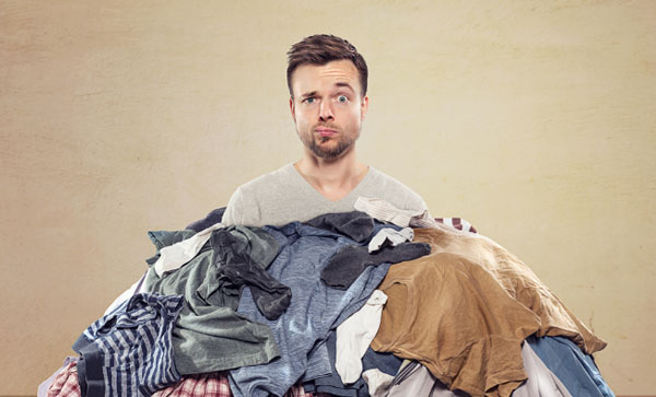 Consumer Storage with Pick up and Delivery- A man with a pile of clothes