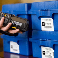Offsite Tape Vaulting - Employee scanning tape storage boxes