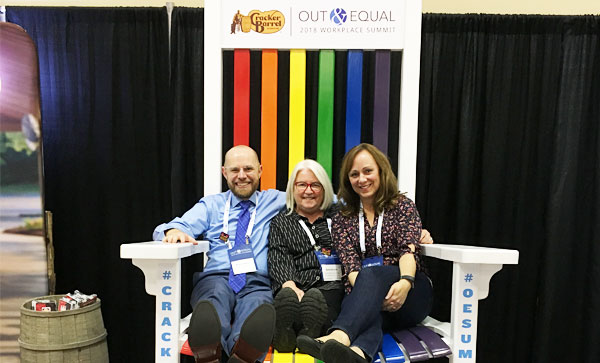 Iron Mountain Presents at the Out & Equal Conference- Three people sitting on a chair