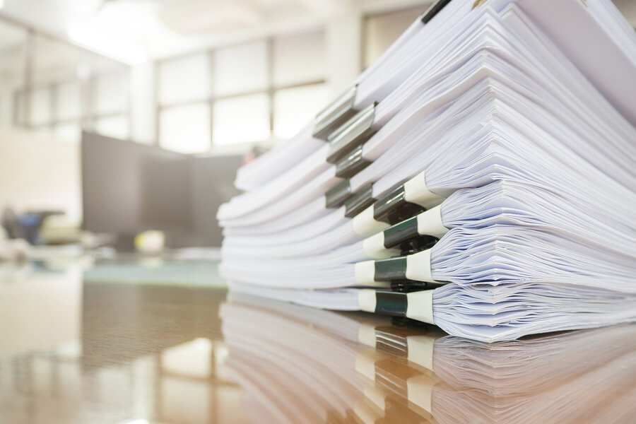 Pile Of Unfinished Documents On Office Desk, Stack Of Businesspa