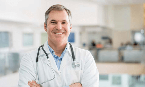 Doctor With Stethoscope- Compliance Lessons For Retiring Physicians Sponsored By: How To Avoid Risk When Closing A Practice | Iron Mountain