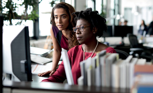 The Essential Guide to Understanding Digital Transformation -Women working | Iron Mountain