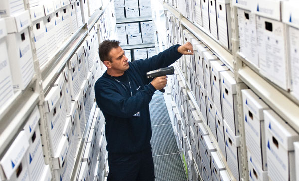 Iron Mountain Project Services Solutions to help manage a variety of records challenges- Man scanning | Iron Mountain