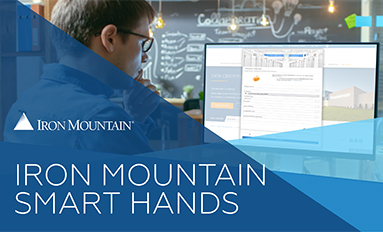 Iron Mountain Smart Hands article thumbnail - photo of a man looking at a computer screen