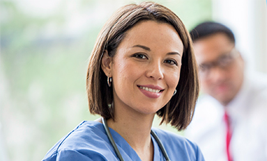 ROI Staffing After Hours - photo of a woman in scrubs with a stethoscope around her neck