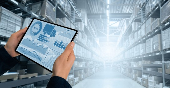 4 Digitization Best Practices to Follow Now and After the COVID-19 Pandemic- A person checking warehouse data in his tablet