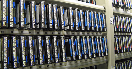 Backup vs. Archive: Know the Difference - Shelf with tapes