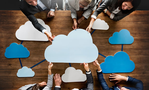 Important Considerations Concerning SITAD in Rush to Cloud - Business people in meeting | Iron Mountain