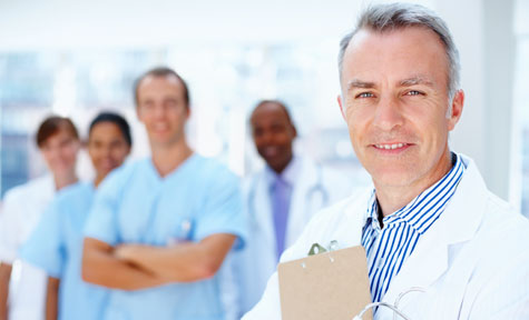 Improving Patient Matching in Healthcare Organizations - A doctor smiling