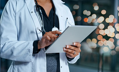 Is a Web-Based EMR in Your Future? - A doctor looking at web based medical records