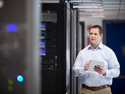 RIM: Five Ways to Put Your IT in Overdrive- An employee in a server room