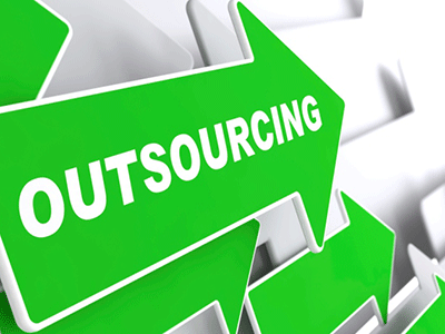 Outsourcing IT-  Outsourcing word on Arrrow board