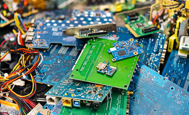 Overcoming Challenges in Recycling Electronics and Secure Media Destruction - E-waste heap from discarded laptop parts