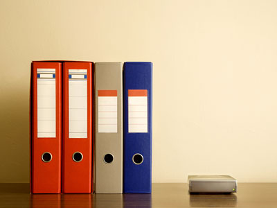 Three Benefits of Going Paper-lite - Stack of files