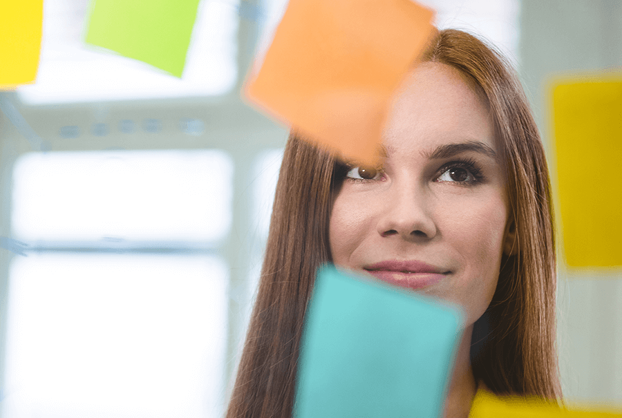 Woman looking at post it notes