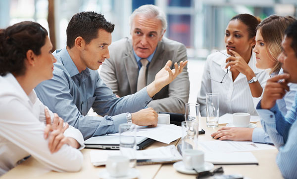 Business Continuity Strategies to Help You Minimize Downtime- People in a meeting