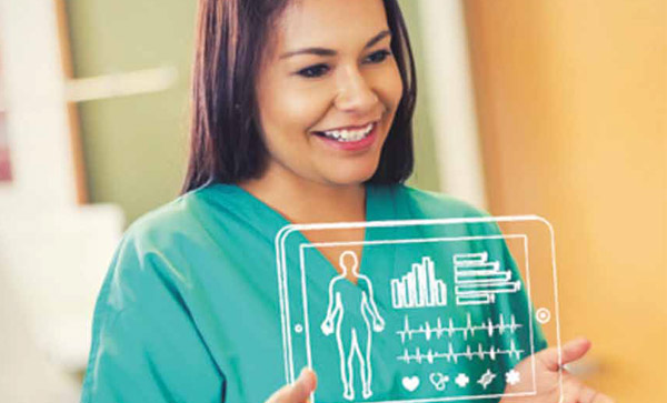 Health Information Management: Getting it Right From the Start - A nurse holding a tablet up