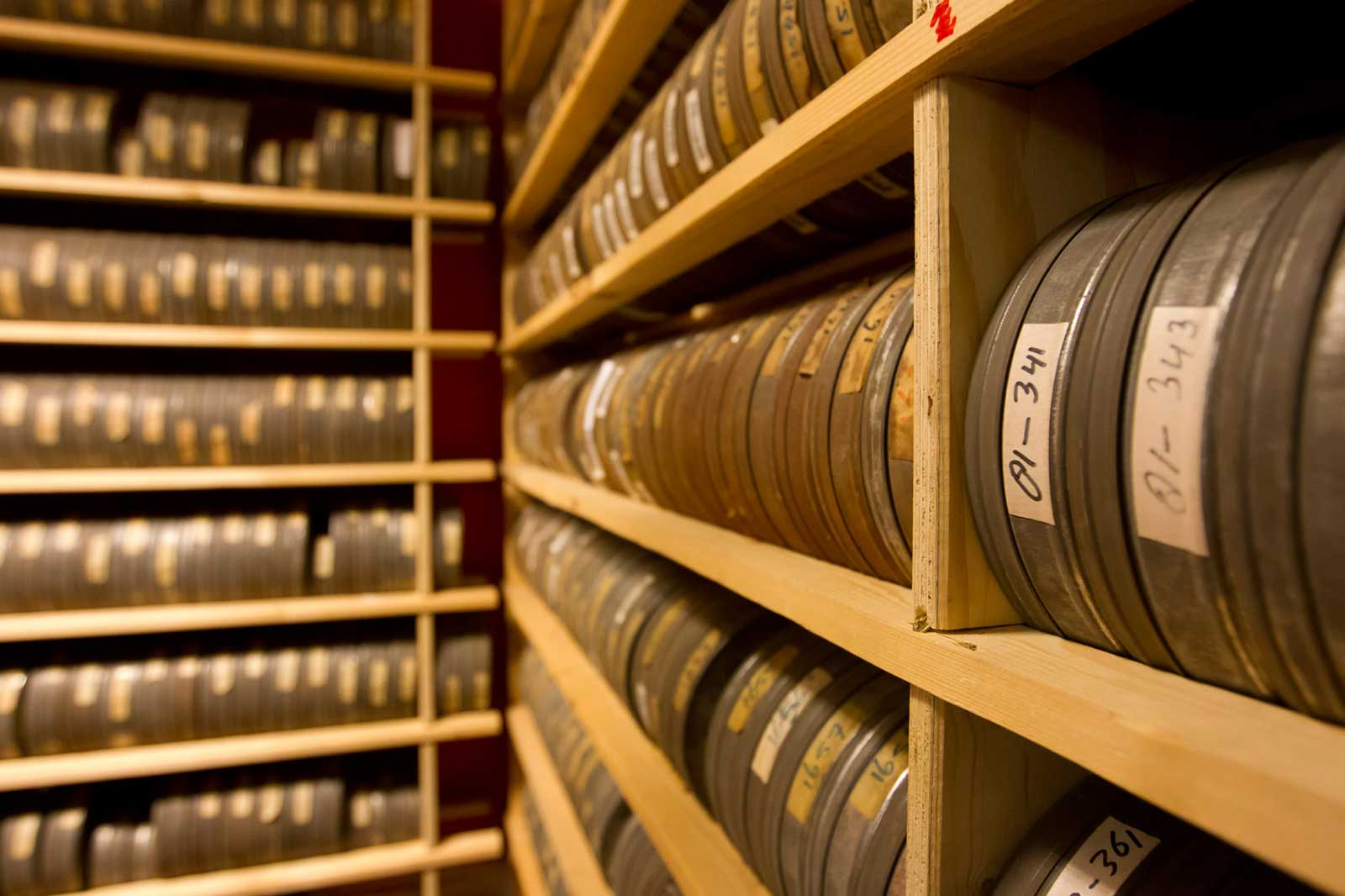 commercial productions banner - room full of film reels