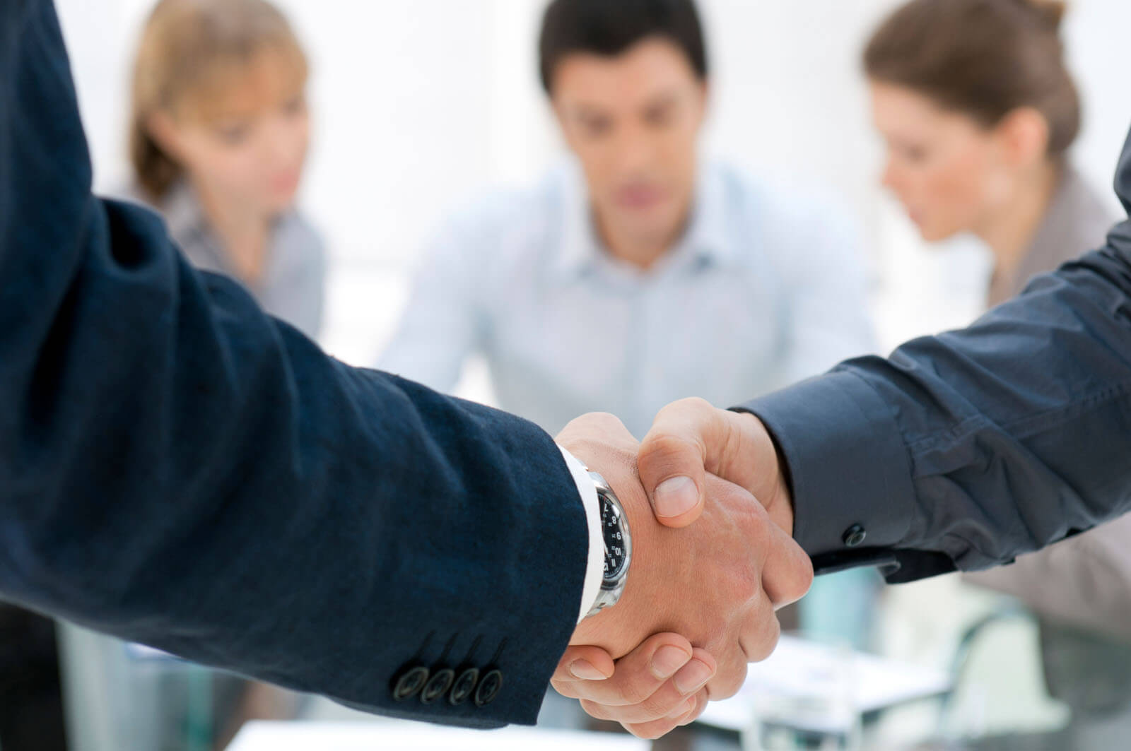 Contracts for federal agencies- Two people shaking hands