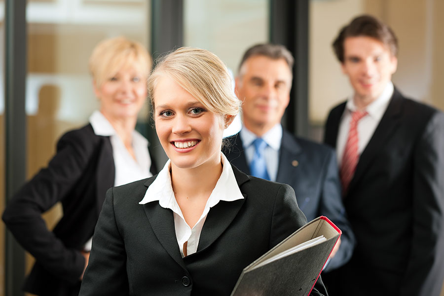 Law Firms- Four people in suits smiling