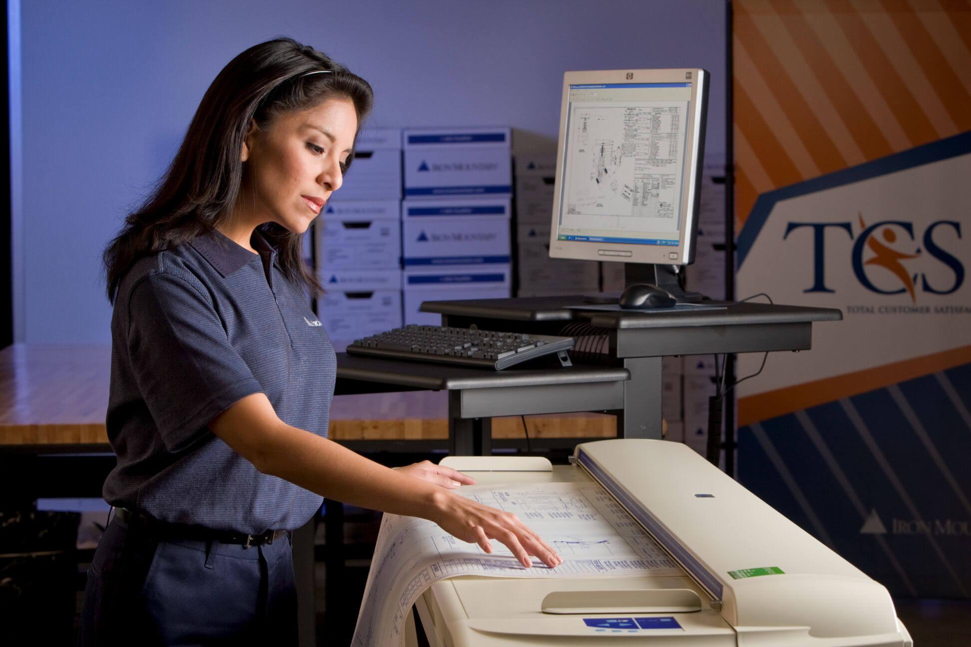 iron-mountain-employee-scanning-document