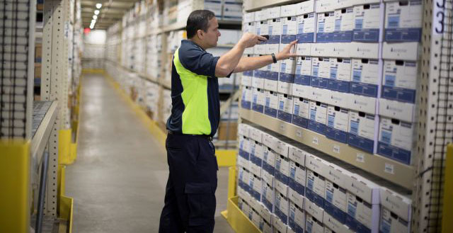 iron-mountain-employee-scanning-boxes-in-storage-facility