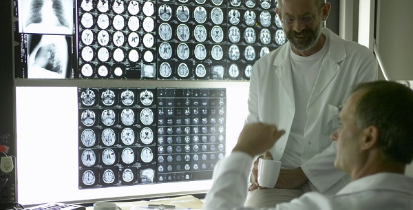 Doctors looking at medical films