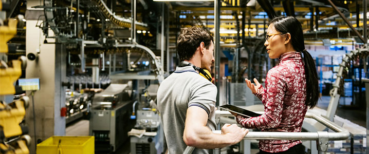 Manufacturing and Engineering- Mechanic and an engineer talking in factory