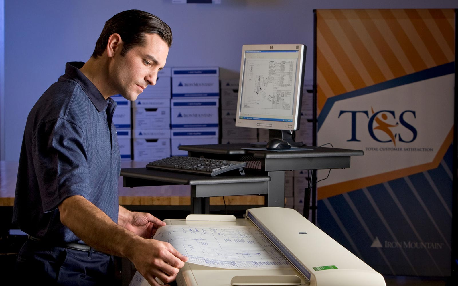 image on demand banner - iron mountain employee scanning document