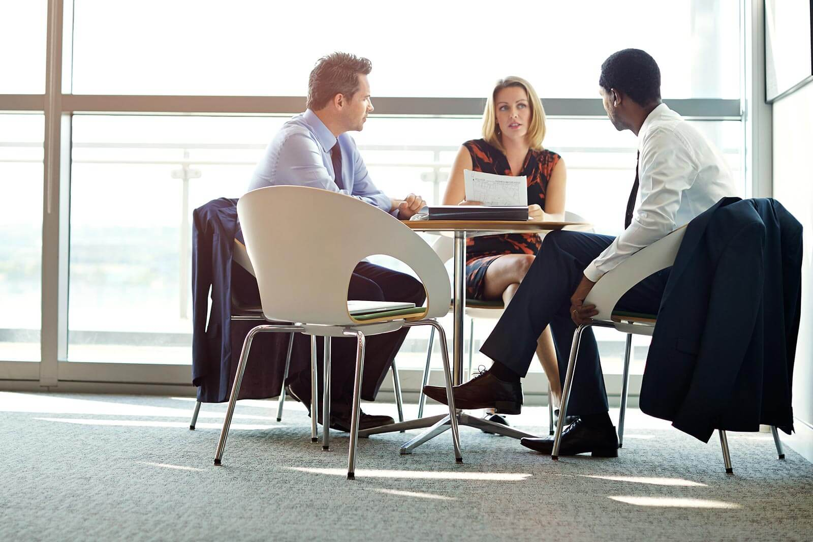 Advisory Services Banner - business meeting between three people