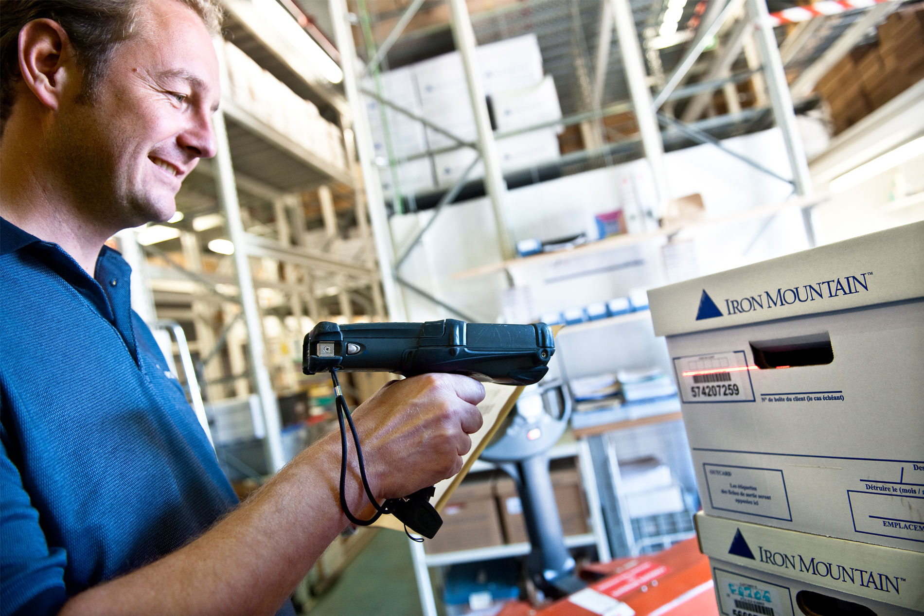 Iron Mountain Employee scanning boxes in storage facility