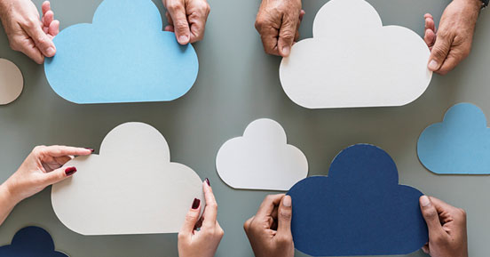 Is the Cloud the best solution for storing all your data- People holding tiny cloud shaped cards