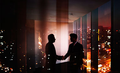Privacy Is Paramount in a Digital Workplace- Businessmen shaking hands