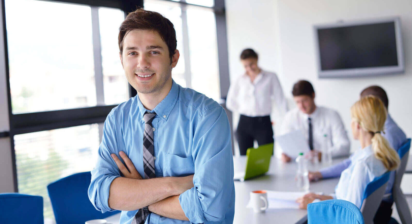 small business solutions banner - business man looking at camera