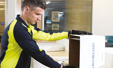 Project Services To Manage Your Records Challenges - Worker packing documents
